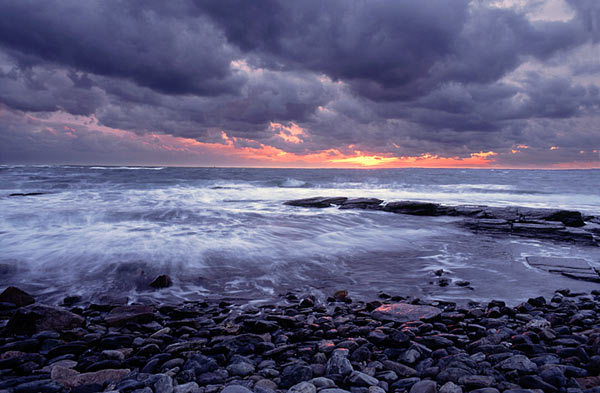 clouds, gray, ocean, pink, rocks, sea, seashore, sky, sunset, water, waves