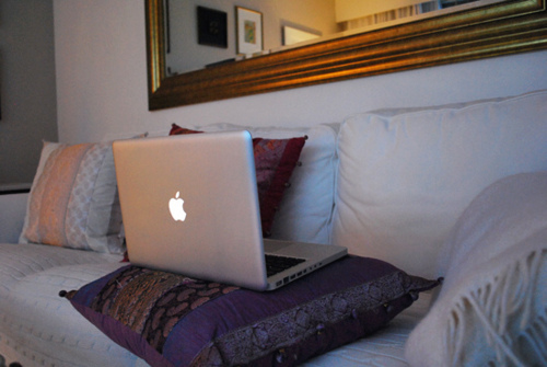 apple, couch, cushions, gold, laptop