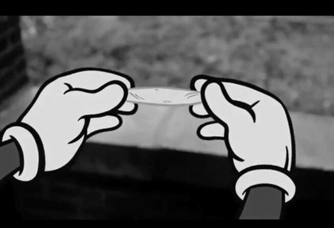 Mickey mouse hands rolling joint