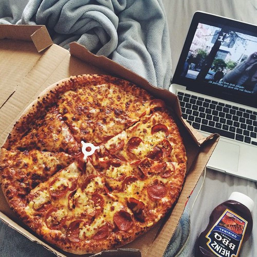 Girl With Pizza In Bed