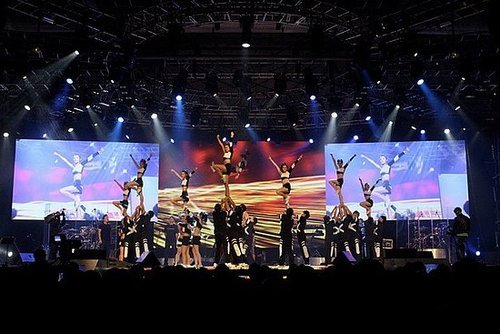 audience, cheer, cheerleaders, cheerleading, flyers, girls, liberty, lights, performance, stage, stunts, torch