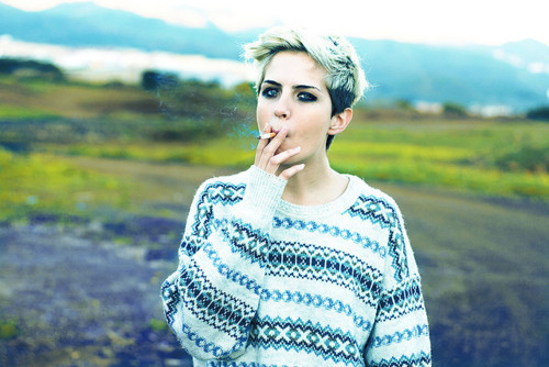 badass, blonde, bokeh, cigarette, fashion, film, girl, hipster, indie, jersey, jumper, knitted jersey, knitted sweater, knitwear, model, mountains, nature, photography, short hair, smoke, style, sweater, vintage