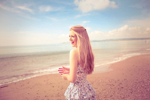 beach, blonde, dress, girl, laugh, ocean, sand, shore, smile, waves