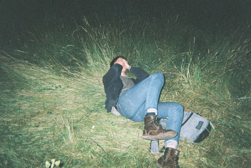 backpack, boots, covered face, flash, grass, lying down, night, separate with comma