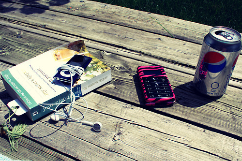 book, carefree, cellphone, ipod, music, my sisters keeper, pop, soda, summer, sun, tanning
