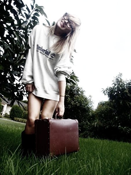 artsy, blonde, glasses and suitcase