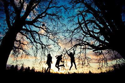 blue, branch, girl, jump, sky, sunset, trees